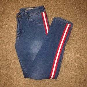Jeans with red and white strip down side